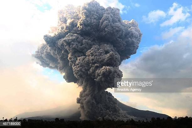 Mount Sinabung spews pyroclastic smoke seen from Tiga Pancur village in Karo district of North Sumatra Indonesia on October 13 2014 Activity of Mount...