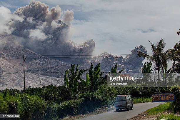 Mount Sinabung spews pyroclastic smoke seen from Tiga Pancur village on June 19 2015 in Karo District North Sumatra Indonesia According to The...