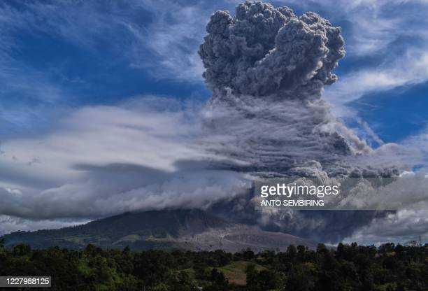 Mount Sinabung spews thick ash and smoke into the sky in Karo, North Sumatra on August 10, 2020.