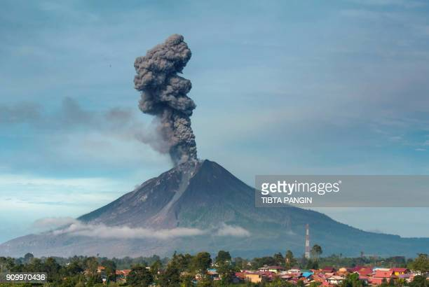 TOPSHOT Mount Sinabung volcano spews thick smoke in Karo North Sumatra on January 25 2018 Sinabung roared back to life in 2010 for the first time in...