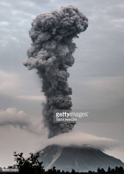 TOPSHOT Mount Sinabung volcano spews thick volcanic ash as seen from the town of Brastagi in Karo North Sumatra province on May 30 2017 Sinabung...