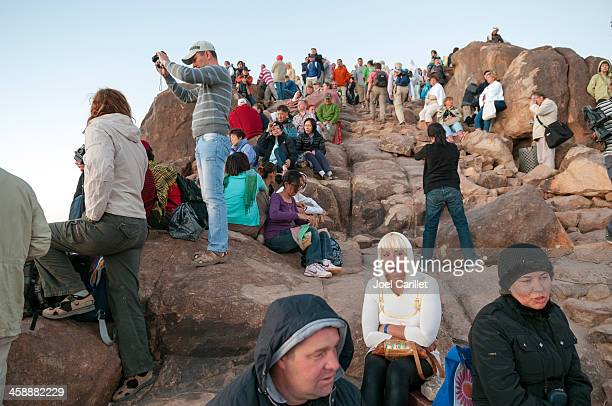mount sinai visitors at sunrise - mt sinai stock photos and pictures
