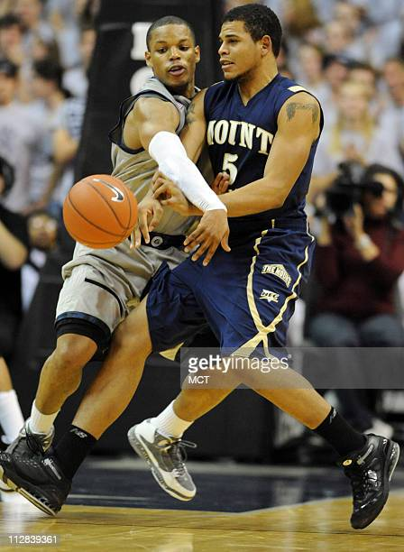 Mount St Mary's forward Pierre Brown gets a pass off while covered tightly by Georgetown guard Chris Wright left in the second half Georgetown...