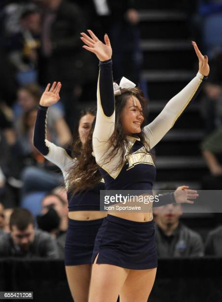 Mount St Mary's Mountaineers cheerleaders cheer during the NCAA Division 1 Men's Basketball Championship game between Wisconsin Badgers and Villanova...