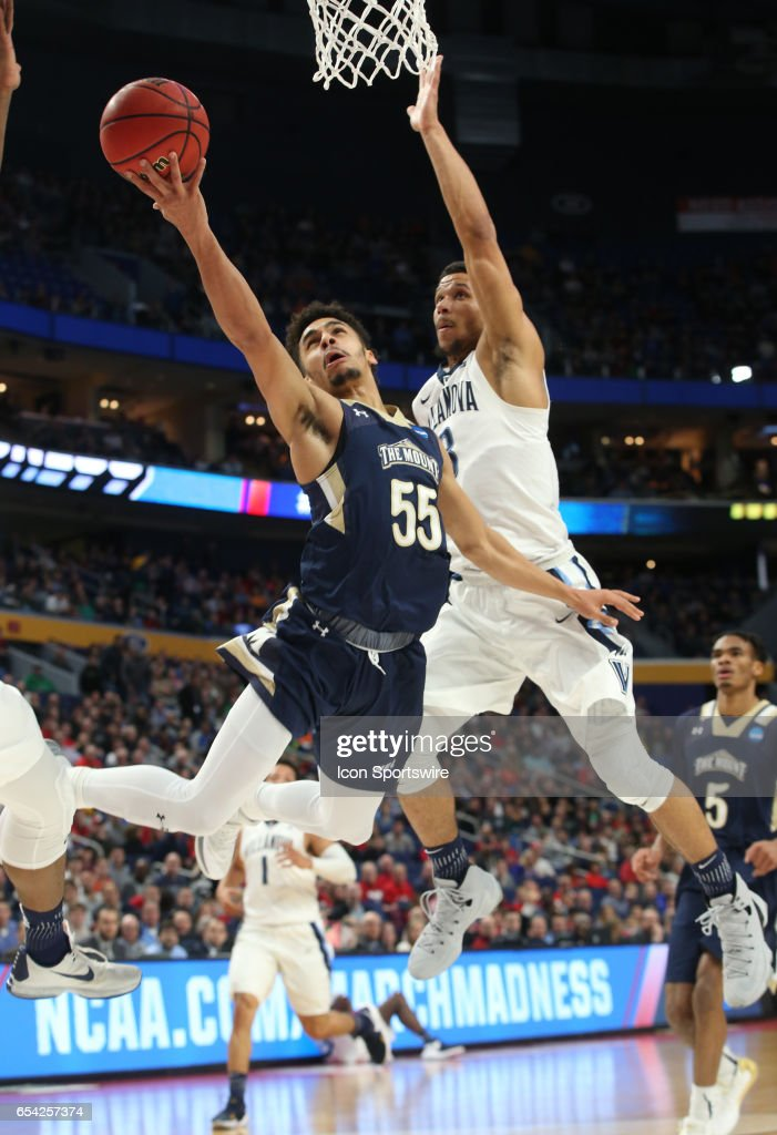 Mount St. Mary's Mountaineers guard Elijah Long (55) is fouled by Villanova Wildcats guard Josh Hart (3) during the NCAA Division I Men's Basketball Championship first round game between Mount St. Mary's Mountaineers and Villanova Wildcats on March 16, 2017 at the Key Bank Center in Buffalo, NY.