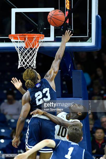 Mount St Mary's Mountaineers guard Greg Alexander blocks the shot of Notre Dame Fighting Irish guard Temple Gibbs during the game between the Mount...