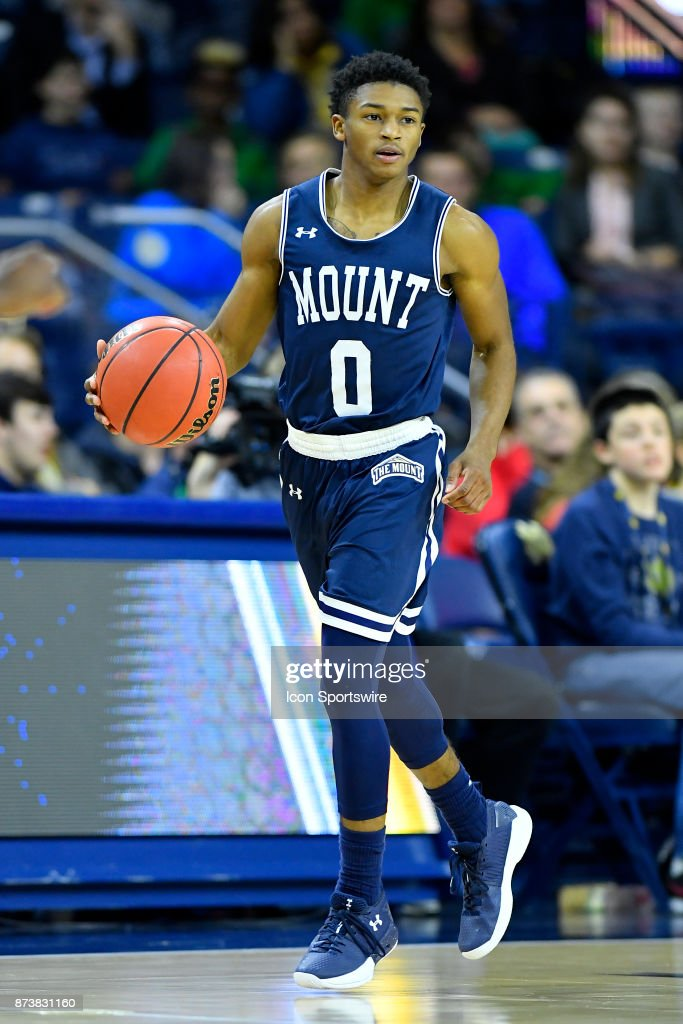 Mount St. Mary's Mountaineers guard Junior Robinson (0) dribbles the ball during the game between the Mount St Mary's Mountaineers and the Notre Dame Fighting Irish on November 13, 2017 at Purcell Pavilion in South Bend, Indiana.
