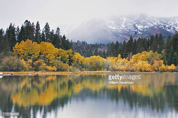 Mount Tallac with new snow and fall foliage reflecting in Fallen Leaf lake near Lake Tahoe in California