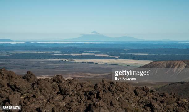 Mount Taranaki (2,518 metres) view from the ridge of South crater in Tongariro national park, New Zealand.