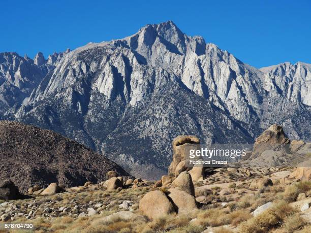 mount whitney and the sierra nevada seen from the alabama hills, lone pine, california - alabama hills stock photos and pictures