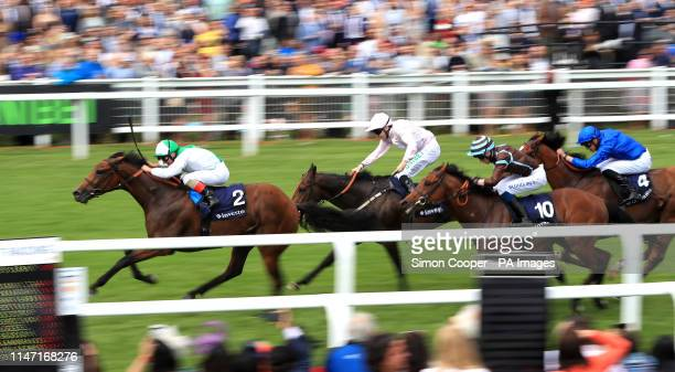 Mountain Angel ridden by Jockey Andrea Atzeni on the way to winning the Investec Wealth Investment Handicap during Ladies Day of the 2019 Investec...
