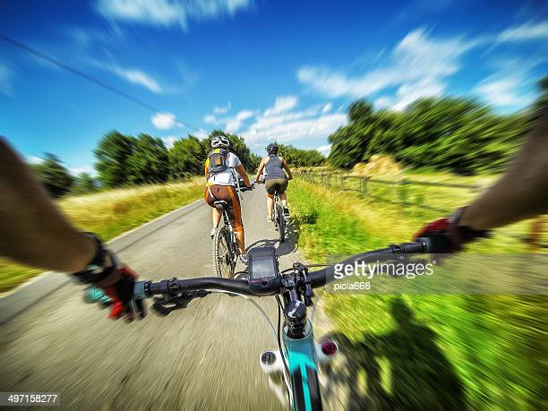 Mountain bicycle in group: on a road in Tuscany