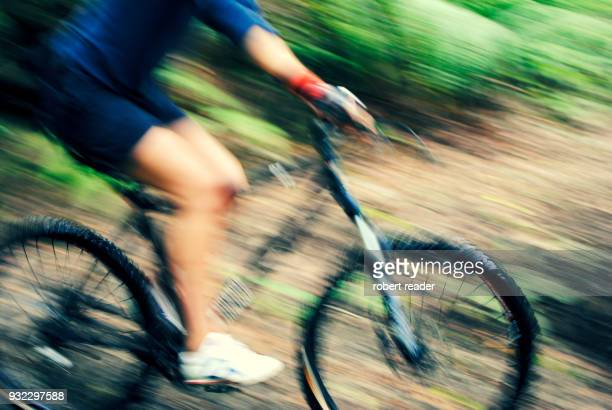 mountain bike and rider moving fast - handlebar stock photos and pictures