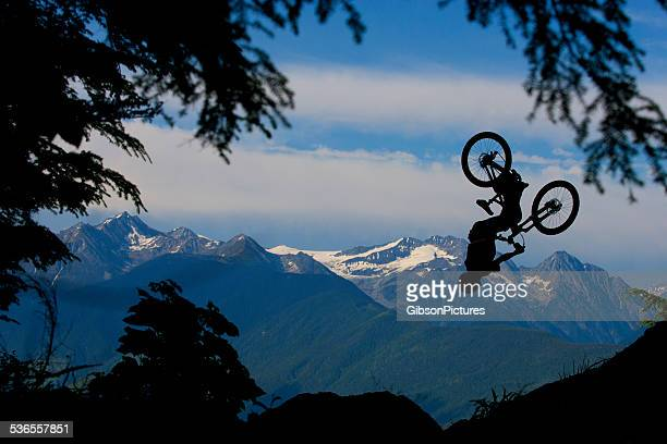 mountain bike back flip - taking the plunge stock photos and pictures
