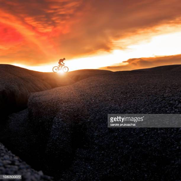 mountain bike cyclist cycling on the hill mountain twilight time on top of a mountain , extreme sport concept. - downhill skiing stock pictures, royalty-free photos & images