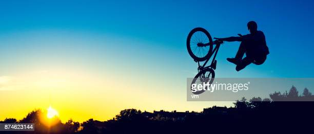 mountain bike jump - bmx cycling stock pictures, royalty-free photos & images