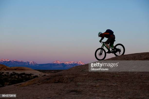 mountain bike moab utah - bicycle trail outdoor sports stock photos and pictures