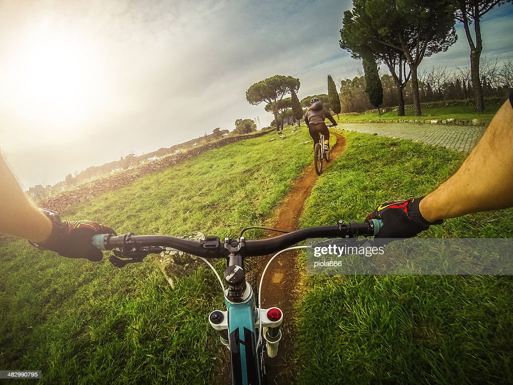 Mountain Bike on the Via Appia Antica and Aqueduct : Stock Photo
