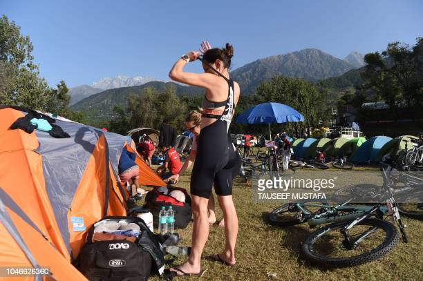 Mountain bike racer prepares ahead of the final day of the 14th edition of the Hero MTB Himalaya mountain bike race during a final day at Dharamshala...