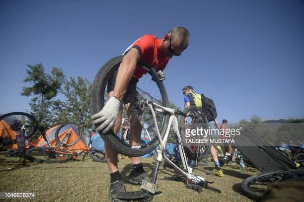 TOPSHOT Mountain bike racer prepares ahead of the final day of the 14th edition of the Hero MTB Himalaya mountain bike race during a final day at...