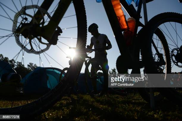 Mountain bike racer prepares ahead of the final day of the Hero MTB Himalaya mountain bike race at a rest camp in Kangra district on the northern...