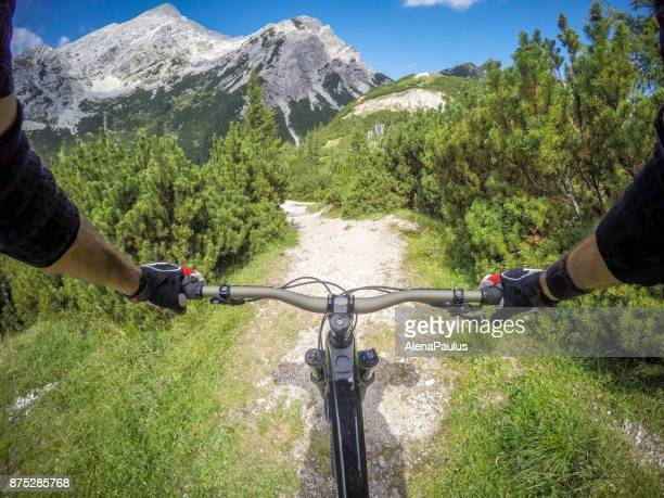 mountainbike ride in alps pov - handlebar stock photos and pictures
