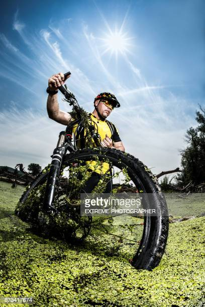 mountain bike rider in the swamp - endurance race stock pictures, royalty-free photos & images