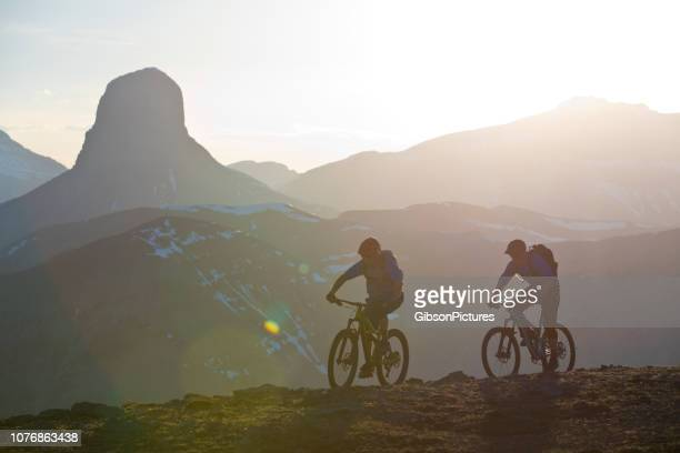 mountain bike sunset adventure - sports equipment stock pictures, royalty-free photos & images