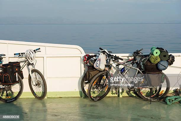 mountain bike with camping equipments - mytilene stock photos and pictures