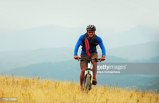 Mountain biker at scenic valley