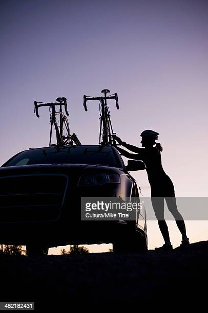 Mountain biker attaching bikes to car