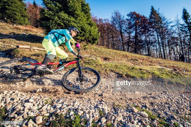 Mountain biker before a fall on a gravel footpath