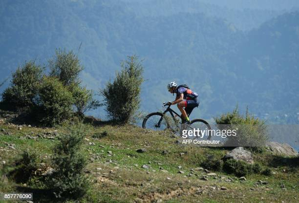 61465069e32 A mountain biker competes in the Hero MTB Himalaya mountain bike race near  Barot village in