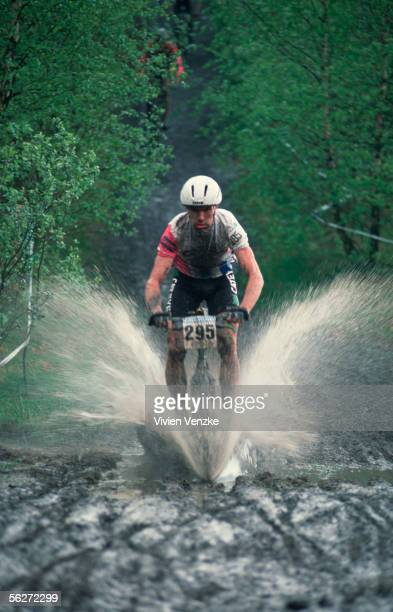 Mountain Biker cycling through woodland during the Stevens Cup on May 11, 1997 in Norderstedt, Germany.