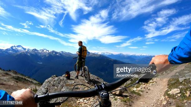 pov of mountain biker descending mountaintop trail - ascent xmedia stock pictures, royalty-free photos & images