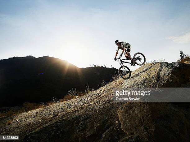 Mountain biker descending on slick rock trail