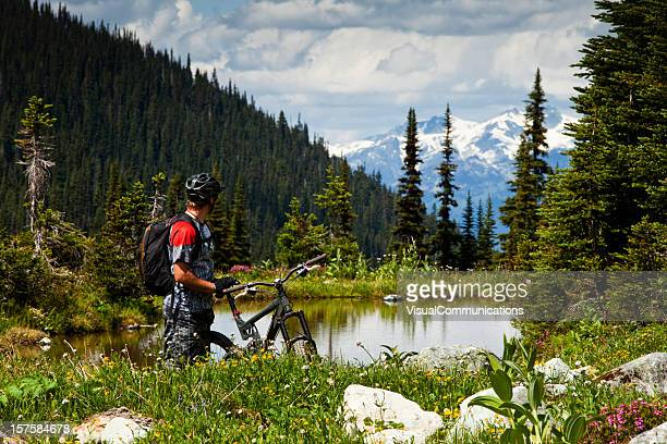 Mountain biker enjoying view.