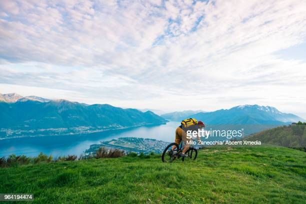 Mountain biker follows alpine track, down mountainside
