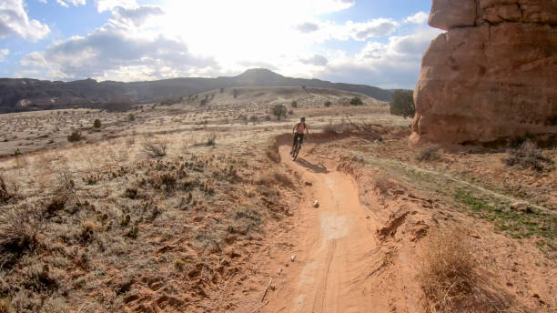 Mountain biker follows desert trail, canyon lands