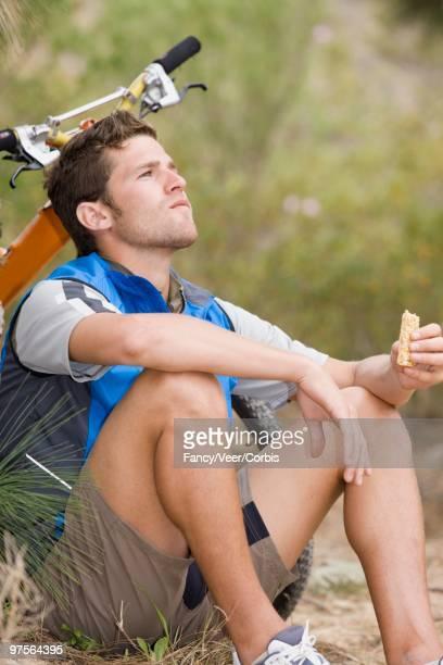 Mountain biker having a snack