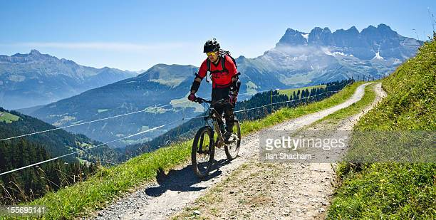 Mountain biker in front of Dents Du Midi