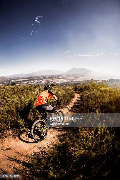 Mountain biker in the moutains doing a cross country trail
