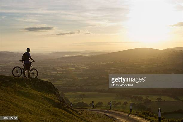 Mountain biker looking at the sunset.