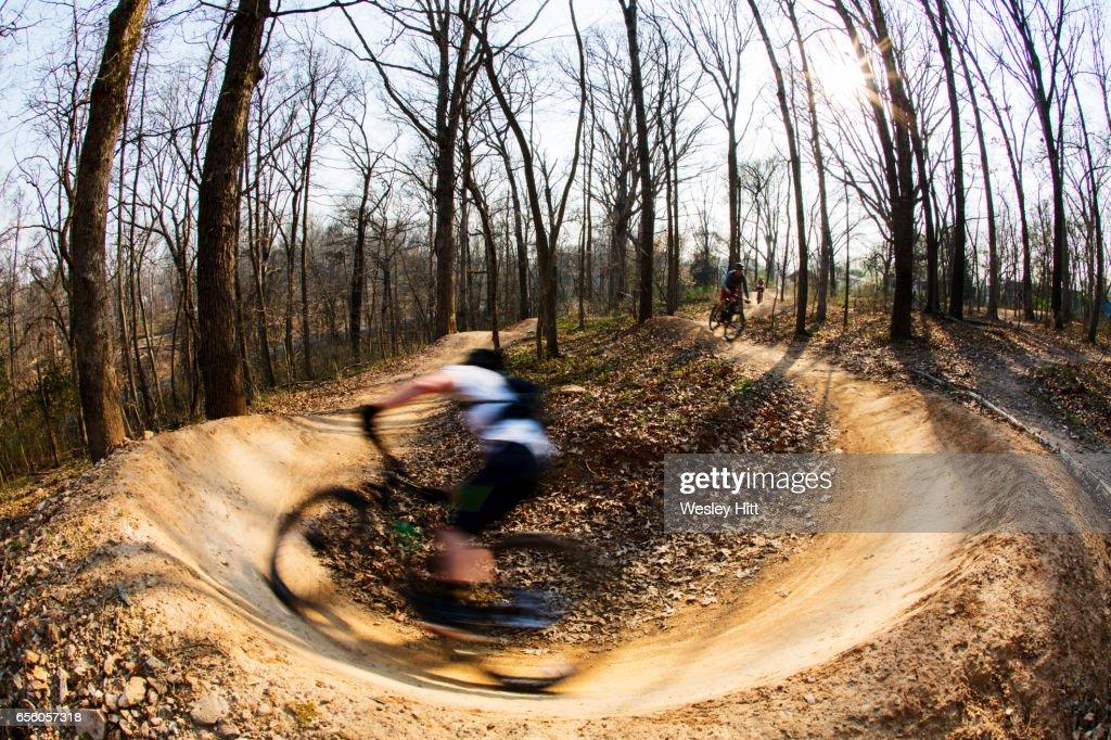 mountain biker making a turn in the dirt : Stock Photo