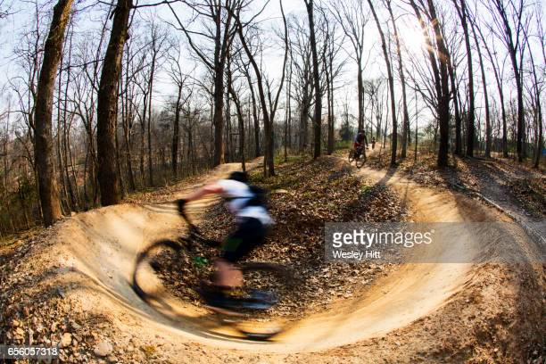 mountain biker making a turn in the dirt