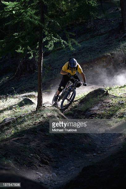 mountain biker on dirt path - mountain bike stock pictures, royalty-free photos & images