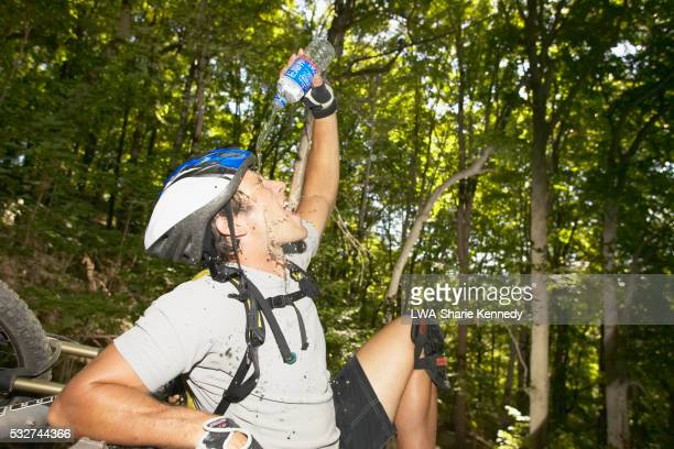 Mountain Biker Pouring Water on His Face