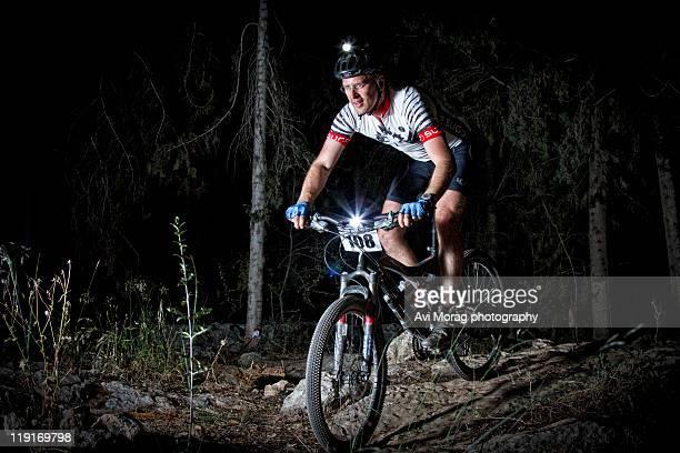 Mountain biker riding at night