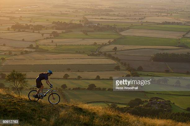 Mountain biker riding down a hill.