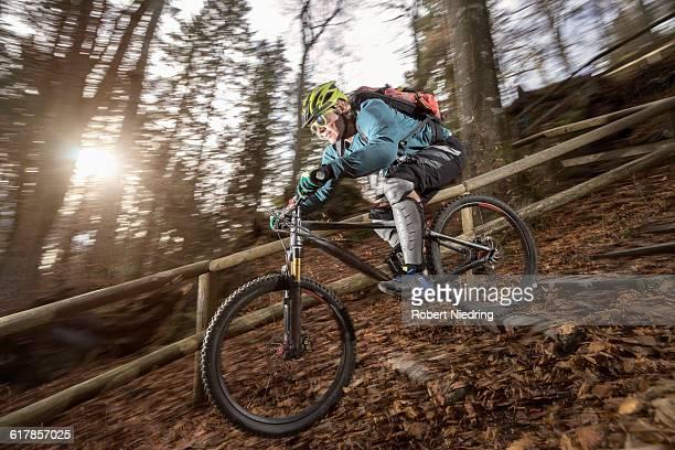 'Mountain biker riding downhill through stairway, Bavaria, Germany'